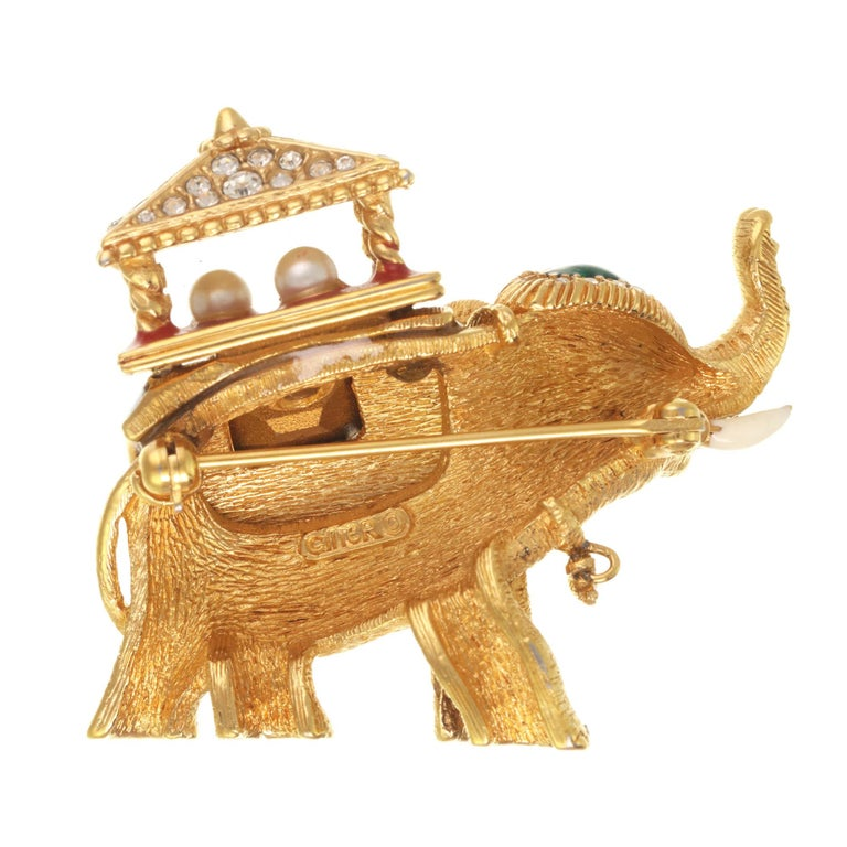 Trunks up! This gorgeous lucky elephant pin features a gorgeous pagoda with a royal blue blanket, encrusted with crystal rhinestones and a faceted emerald rhinestone. A truly gorgeous collectible piece, this pin has vintage appeal.  PLEASE NOTE: The