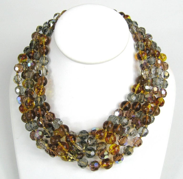 5 Strand Ombre Ciner Necklace. Purchased in the late 1980s and never worn. It has stunnignAmber, yellow to clear on the faceted beads. Measuring 19 inches end to end. Beads measure  9.5 mm. Still has Neiman Marcus tag attached. This is out of a
