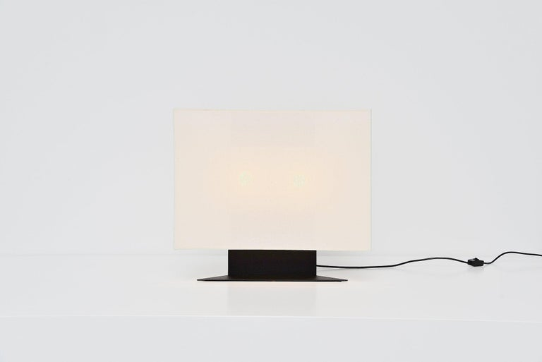 Rare and large table lamp model Accademia designed by Cini Boeri and manufactured by Artemide, Italy, 1978. The lamp has a black painted metal base and a white fabric shade. Very nice Minimalist shaped table lamp. Gives nice light when lit and is in
