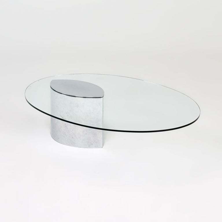 Cini Boeri Lunario cocktail coffee table produced in the 1970s and imported from Italy to UK in the 1980s.  Chromed steel cantilever design, extremely heavy piece. The glass has V.A.C. etched on it, couple of chips and some manufacturer marks,