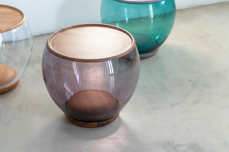 Ciocio is a side table inspired by the natural shaping force of water. Resembling a small river pebble, rounded and smoothed by the current, and a single drop of water gently resting on top. A perfect balance in a fleeting moment of stillness. It is