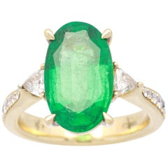 4 3/16 Carat Oval-Cut Emerald and Diamond 18 Karat Yellow Gold Ring