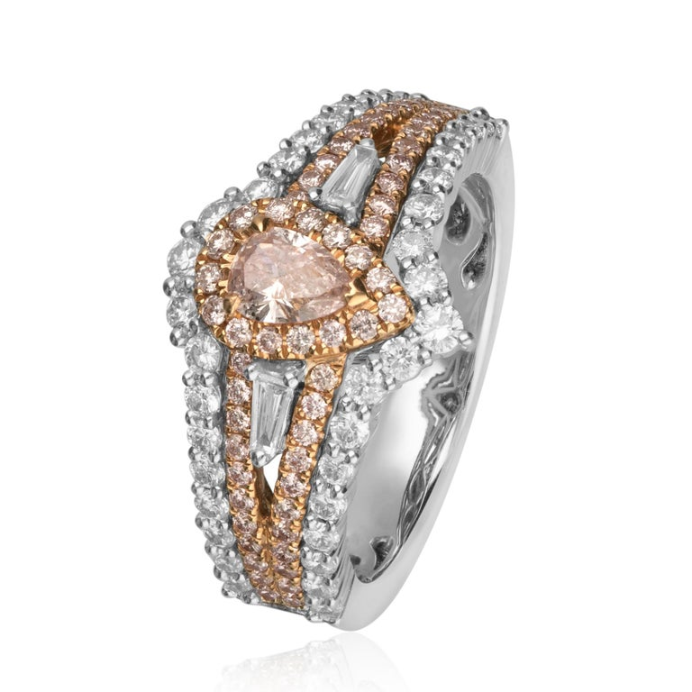 This beautiful Engagement ring is crafted in 18-karat Two Tone (Rose and White) gold.  It features a GIA certified pear shaped Natural Fancy Pink Diamond 0.30 Carat with SI2 clarity, 59 Pink Diamonds 0.39 Carat, 38 Round Diamonds 0.65 Carat and 2