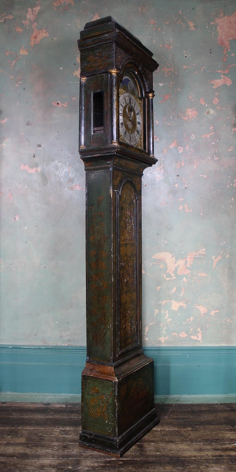 A fine circa 1740 clock by Thomas Haley of North Walsham, an eight day chinoiserie decorated long case clock, the moon faced dial with subsidiary second and date dial, Roman numerals, the green painted chinoiserie and brass inlaid case with