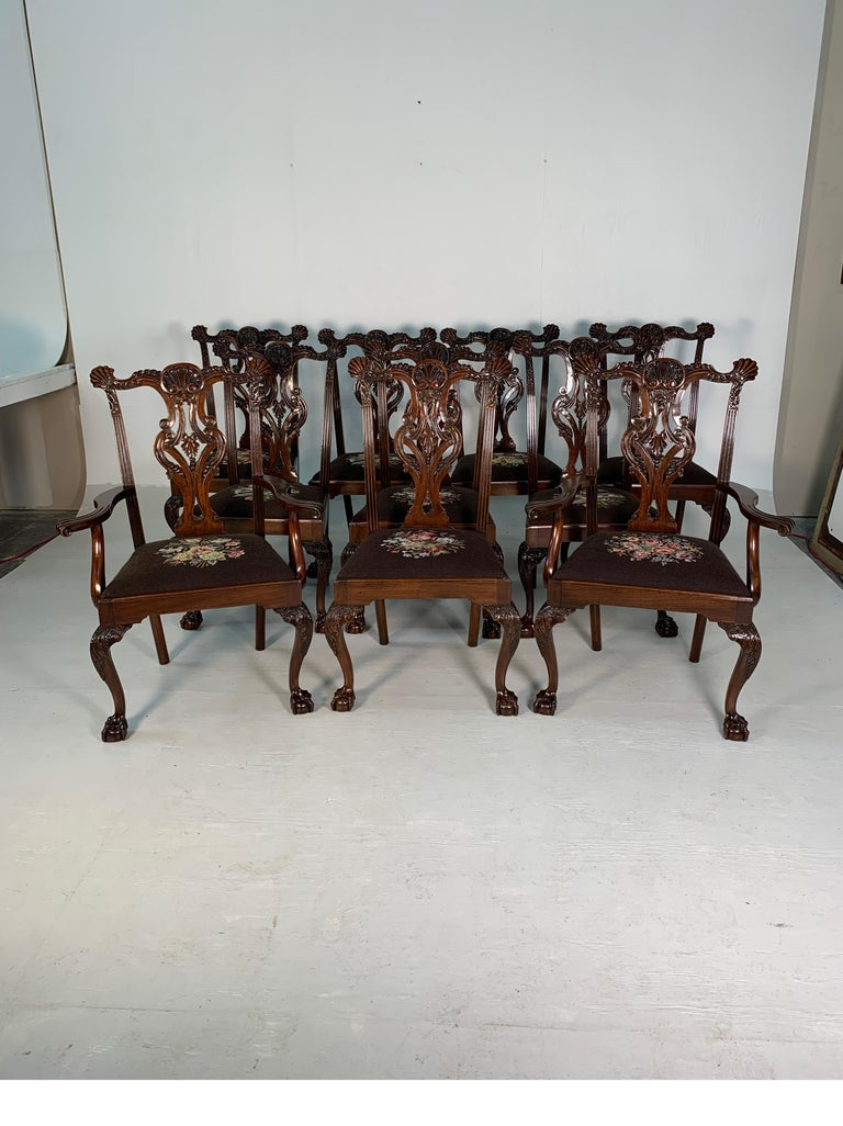 Set of ten beautifully hand carved mahogany Chippendale style chairs, circa 1870. Magnificent detailed carving with great patina, two armchairs and eight side chairs. Really a beautiful addition and statement to any dining room table. Dimensions: