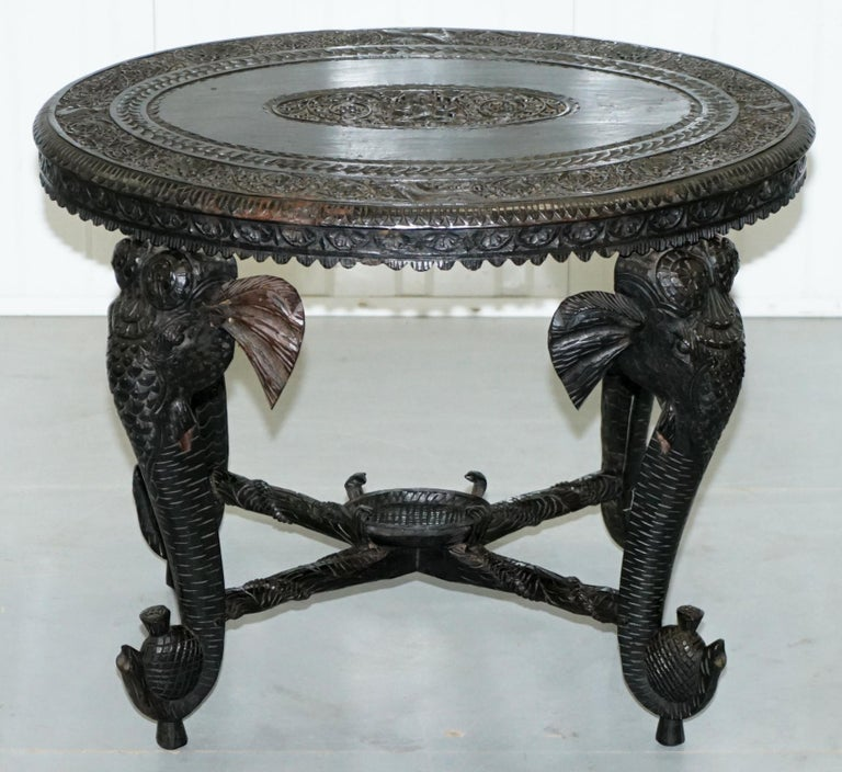 We are delighted to offer for sale this lovely circa 1880-1900 Anglo-Indian hand carved Rosewood coffee or side table with Elephant pillared legs and Buddha carved into the top