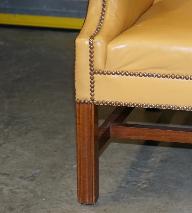 Restored Large Wingback Armchair in Mustard Tan Leather Upholstery, circa 1900 For Sale 3
