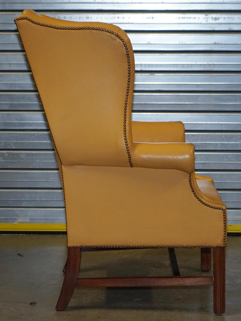 Restored Large Wingback Armchair in Mustard Tan Leather Upholstery, circa 1900 For Sale 4