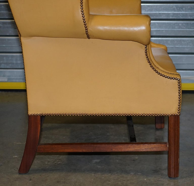 Restored Large Wingback Armchair in Mustard Tan Leather Upholstery, circa 1900 For Sale 5