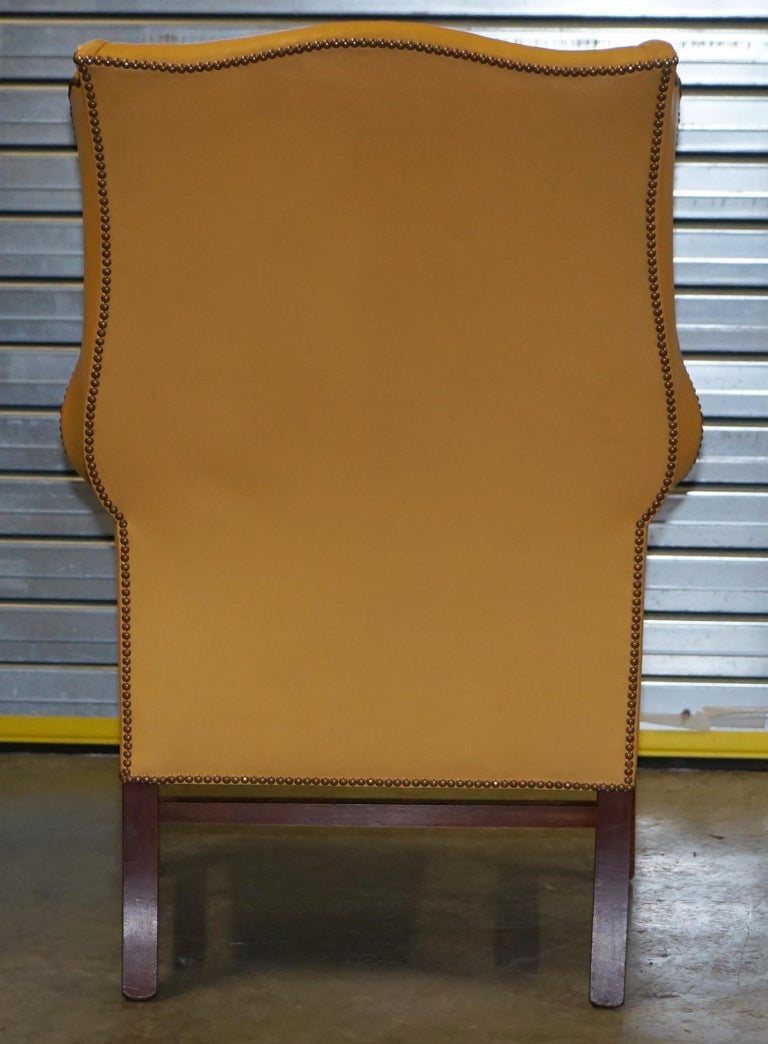 Restored Large Wingback Armchair in Mustard Tan Leather Upholstery, circa 1900 For Sale 8