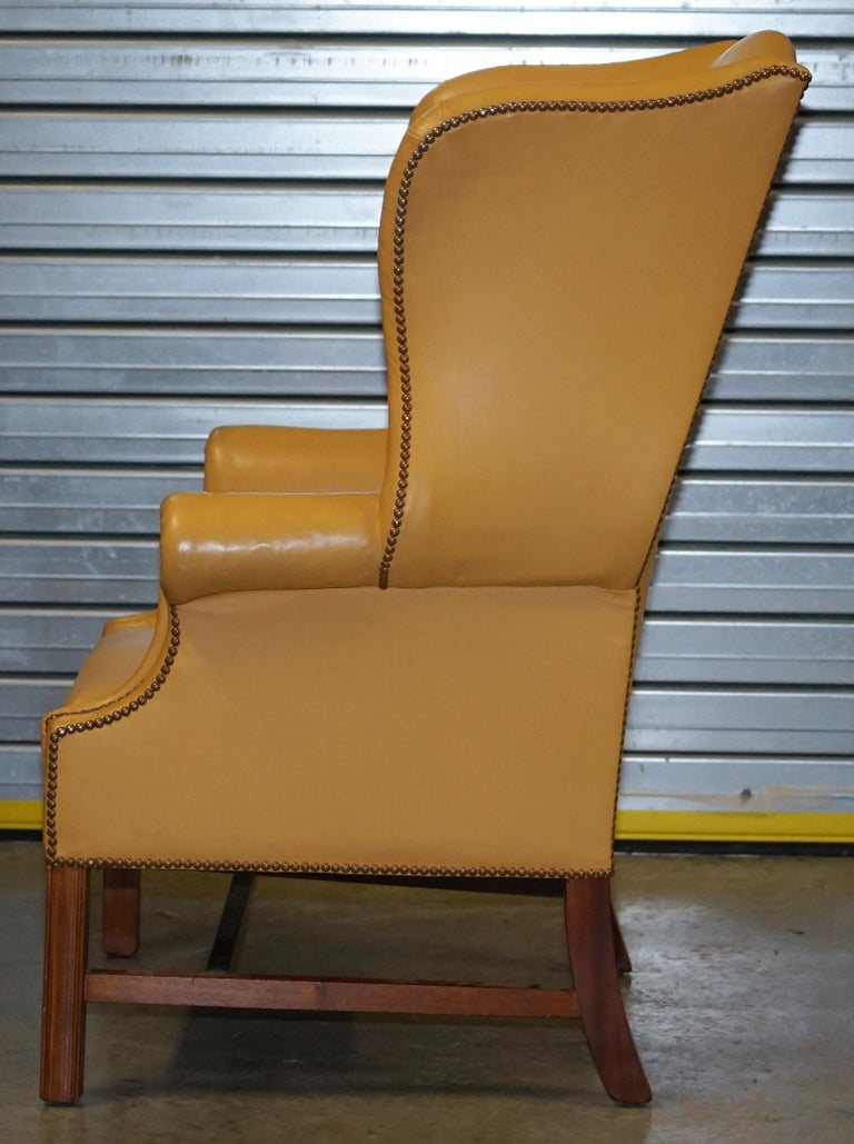 Restored Large Wingback Armchair in Mustard Tan Leather Upholstery, circa 1900 For Sale 9