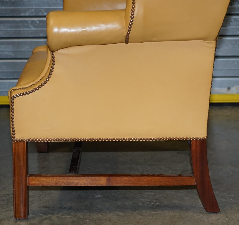 Restored Large Wingback Armchair in Mustard Tan Leather Upholstery, circa 1900 For Sale 10