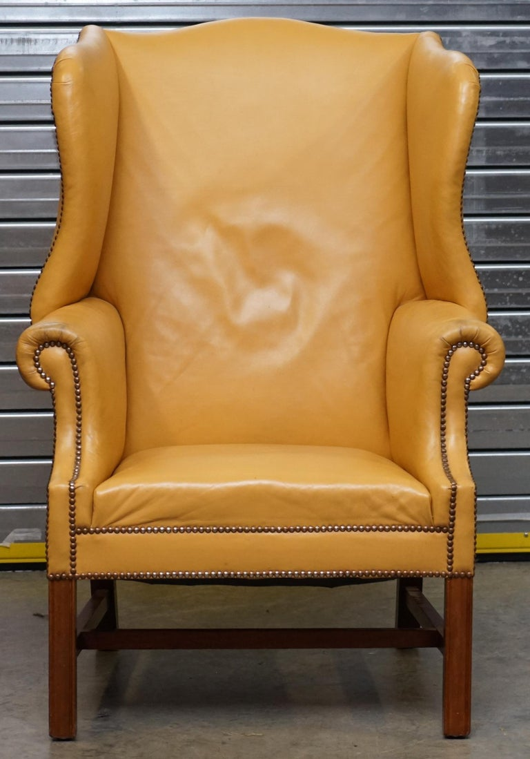 We are delighted to offer for sale this lovely circa 1900 large wingback armchair with restored Mustard tan leather upholstery  This chair was reupholstered in thick leather around 2-3 years ago, it cost £1250 for the work alone, its sat mostly