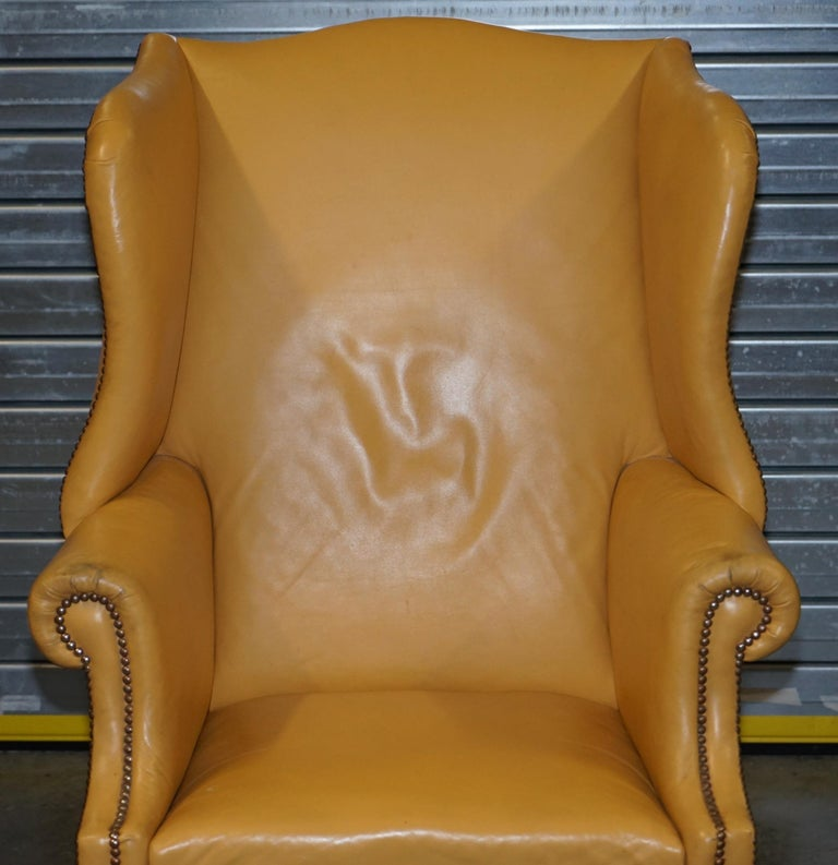 English Restored Large Wingback Armchair in Mustard Tan Leather Upholstery, circa 1900 For Sale
