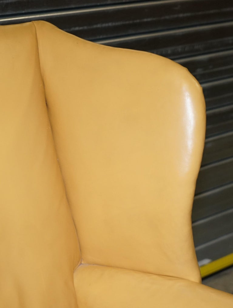 Restored Large Wingback Armchair in Mustard Tan Leather Upholstery, circa 1900 In Good Condition For Sale In London, GB