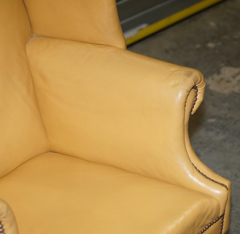 Early 20th Century Restored Large Wingback Armchair in Mustard Tan Leather Upholstery, circa 1900 For Sale
