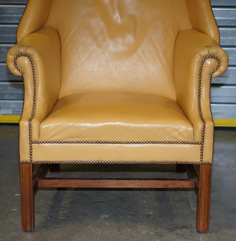 Restored Large Wingback Armchair in Mustard Tan Leather Upholstery, circa 1900 For Sale 1