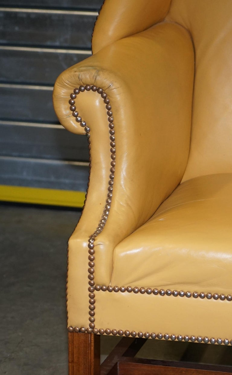 Restored Large Wingback Armchair in Mustard Tan Leather Upholstery, circa 1900 For Sale 2