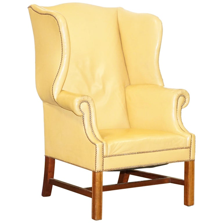 Restored Large Wingback Armchair in Mustard Tan Leather Upholstery, circa 1900 For Sale