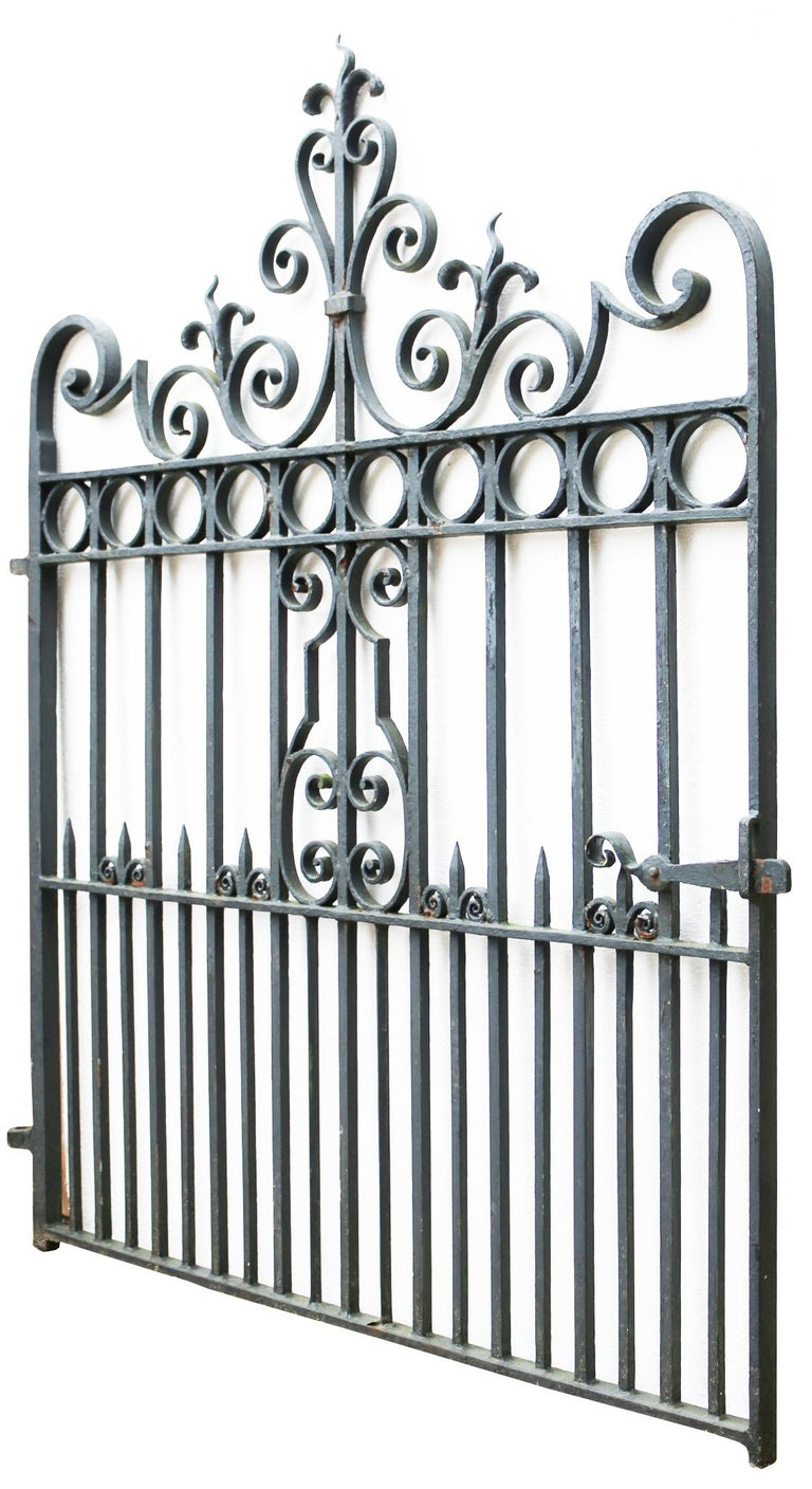 About  This gate has been handcrafted by a blacksmith.   Features faded old back paint with a working latch. English  Condition report:  Minor corrosion with flaking old paint otherwise in good condition for its age.   Style: