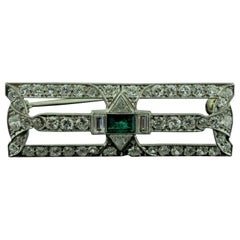 Art Deco Diamond and Emerald Brooch in Platinum, circa 1920