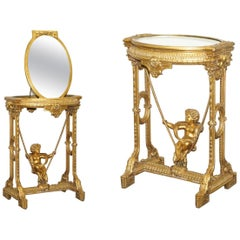 Gold Giltwood Occasional Table with Mirror Top and Cherub Putti Swing circa 1920