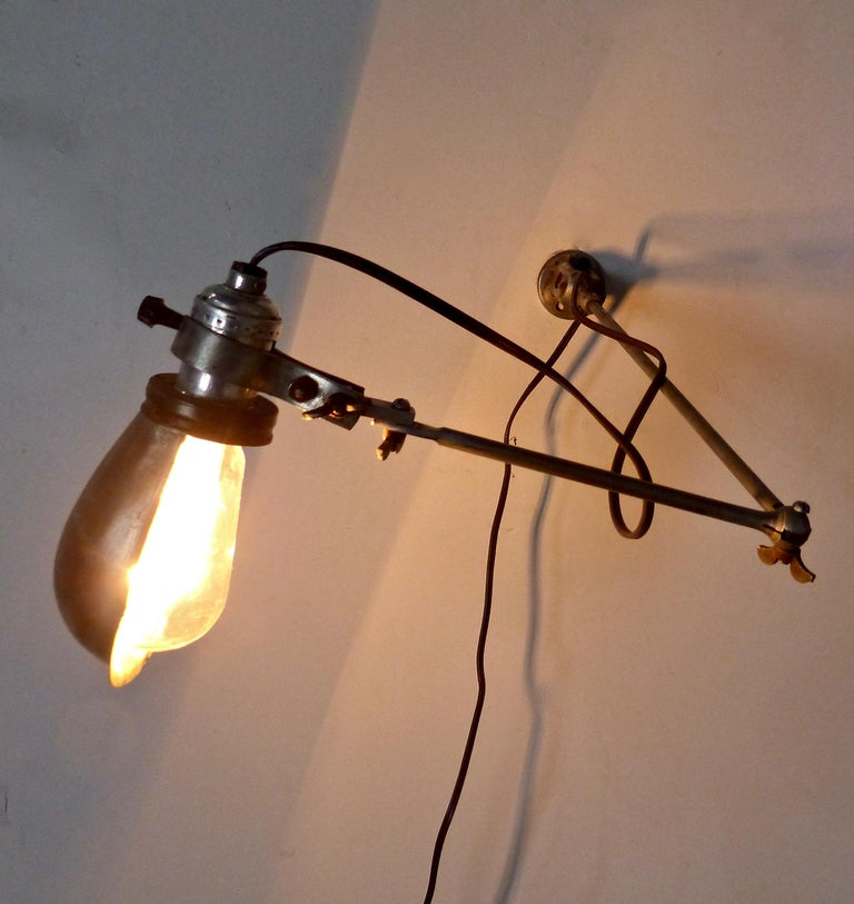 American circa 1920 Metal Articulating Wall Sconce For Sale