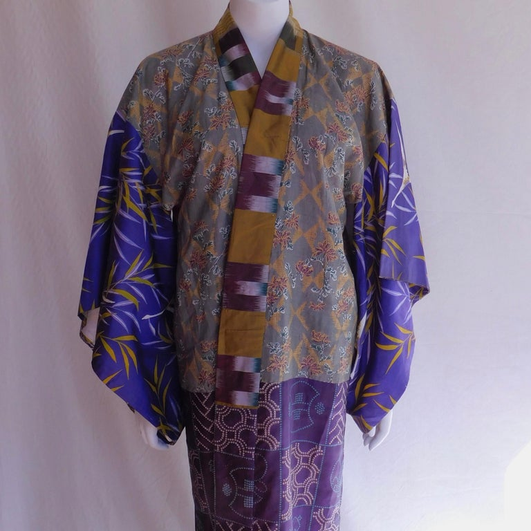 An elegant patchwork Taisho period Japanese juban kimono, circa 1920. Constructed of hand painted and block printed with a silk ikat collar. Soft woven cotton lining. In good overall condition with some wear to bottom hem. Lovely to wear or hang on