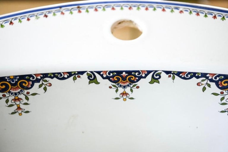 Wonderfully hand painted made in France, this lovely 1920s-1930s Jacob Delafon Art Deco single hole sink for vanity will make a wonderful statement in your powder room or bathroom. Marked underneath. The company Jacob Delafon was founded in 1889 by