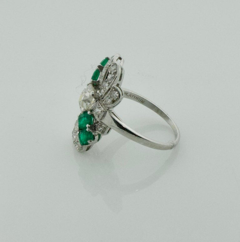 Cushion Cut Diamond and Emerald Ring in Platinum, circa 1930s For Sale