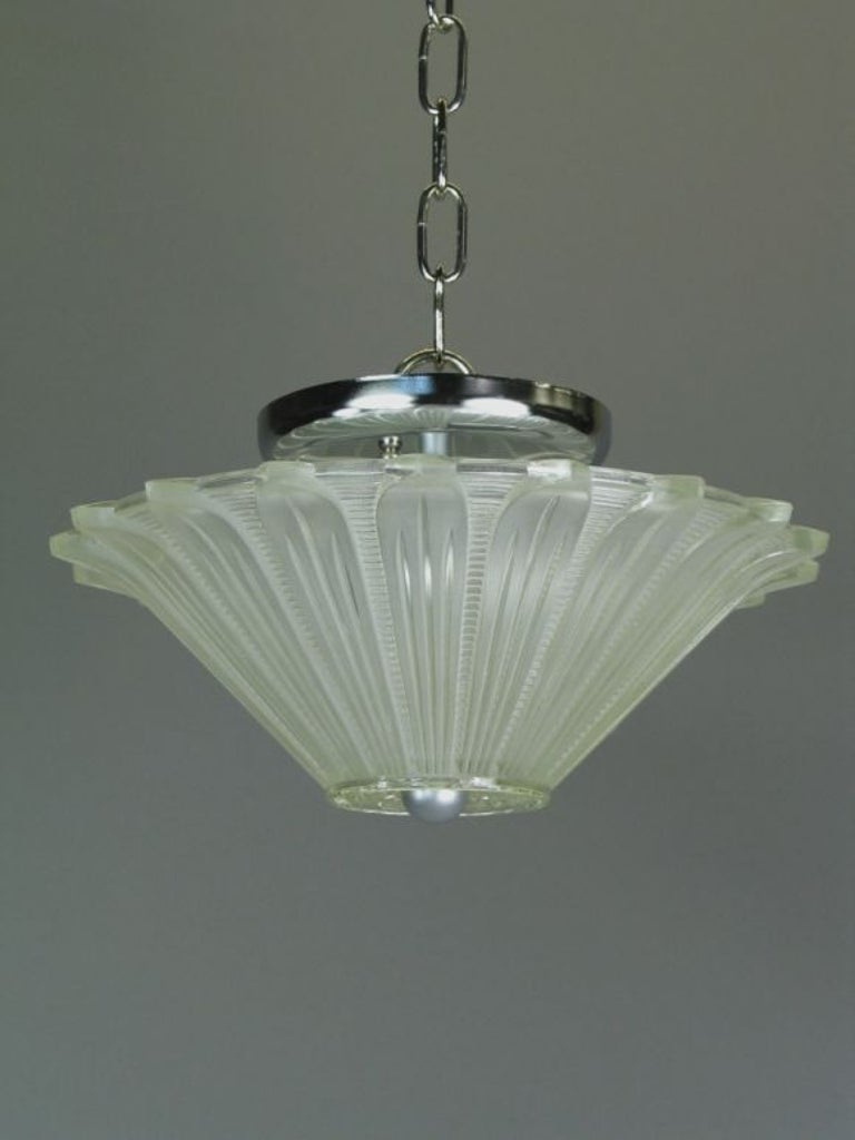 1-4069 two-light frosted glass deco star. Takes 2 60 watt candelabra based bulbs.
