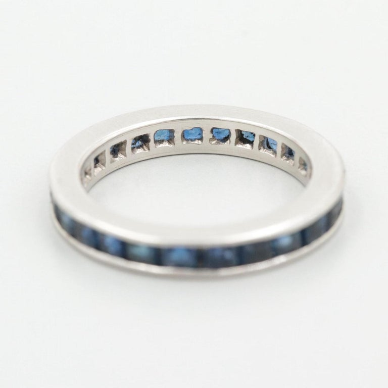 Description:  This piece is a 1950s Art Deco style Platinum wedding band with 1.1 cttw French Cut natural sapphires! A perfect band with a pop of color with beautiful blue sapphires that will pair with your engagement ring on your special day!!