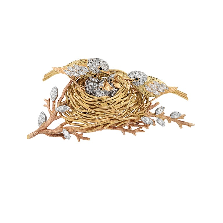 Enchanting Cartier brooch Pin crafted in 18 karat yellow gold and platinum, featuring 117 round brilliant cut and marquise cut diamonds weighing approximately 4.5 carats total, F color, VS clarity. This delightful brooch pin depicts a birds' nest