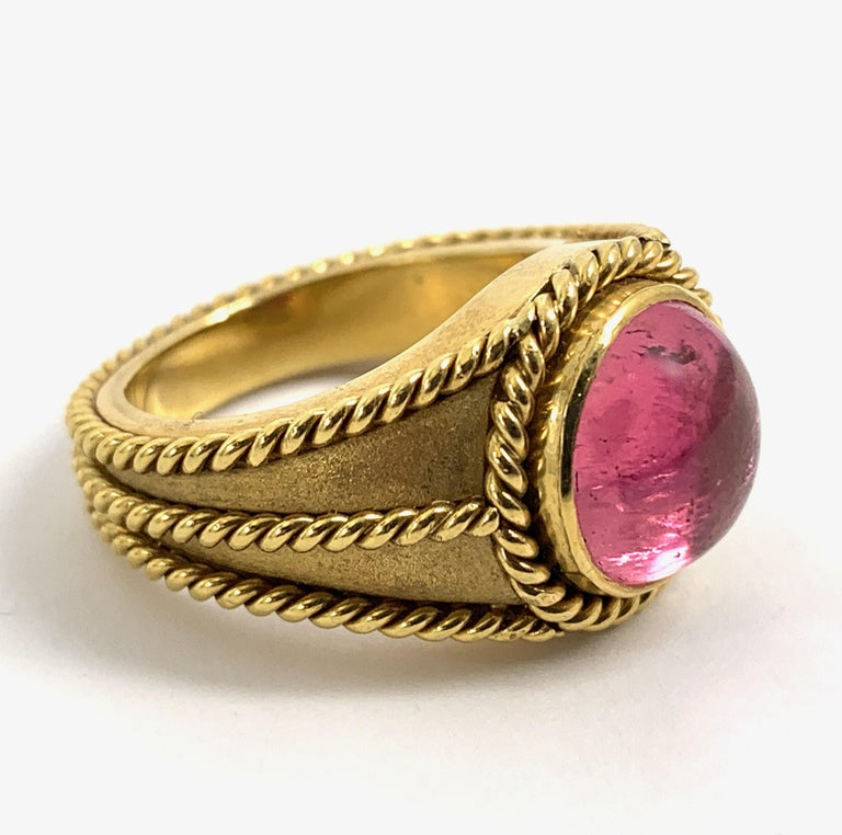 This clean and substantial signet-style ring is all about contrast and delineation. The braiding detail encircles the stone, lines the edges and defines the center, while the lustrous matte finish on the ring's face contrasts beautifully with the
