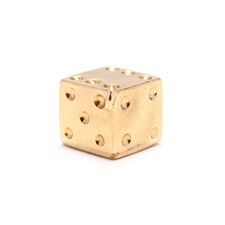 Circa 1970's, a vintage 14 karat yellow gold dice charm. A cube design in a dice motif.  Length: 9/16 in.  1.97 dwts  * Please note that this is a vintage item and may show signs of wear. It has been cleaned.  * Please feel free to message us with