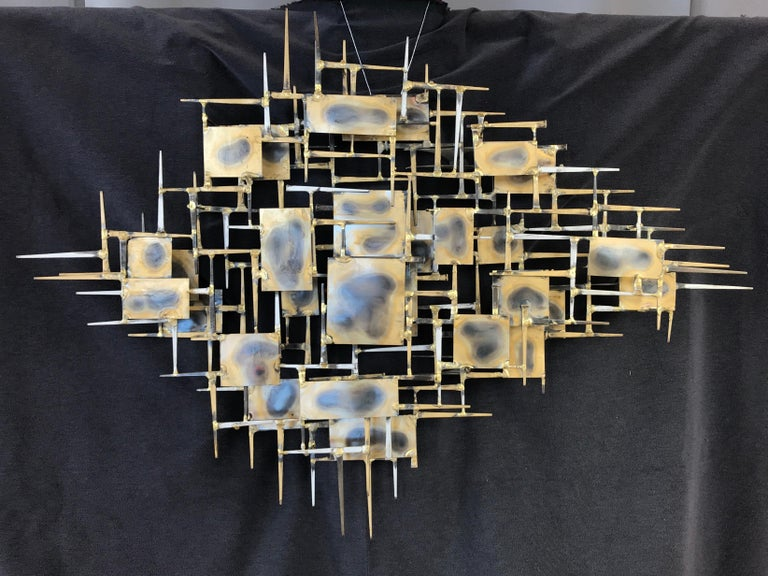A large brutalist abstract wall sculpture by Marc Creates, circa 1978. It's made of nails and plates welded and torched, a classic brutalist sculpture.