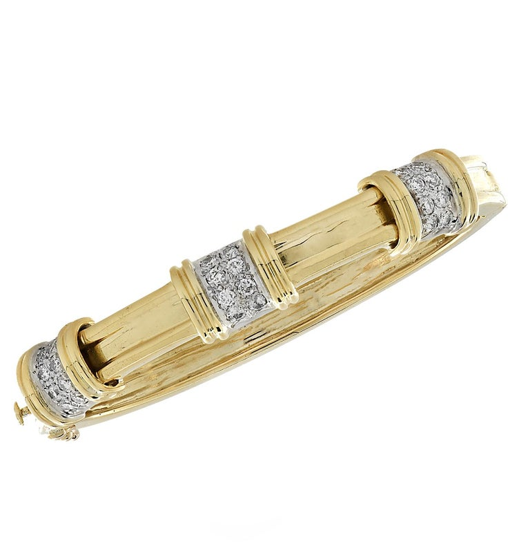 Stunning bangle set crafted in 18 karat yellow gold, featuring 48 round brilliant cut diamonds weighing approximately 2.50 carats total, F color, VS clarity. Three bangles embellished with diamonds, each measuring .25 inches in width, make up this