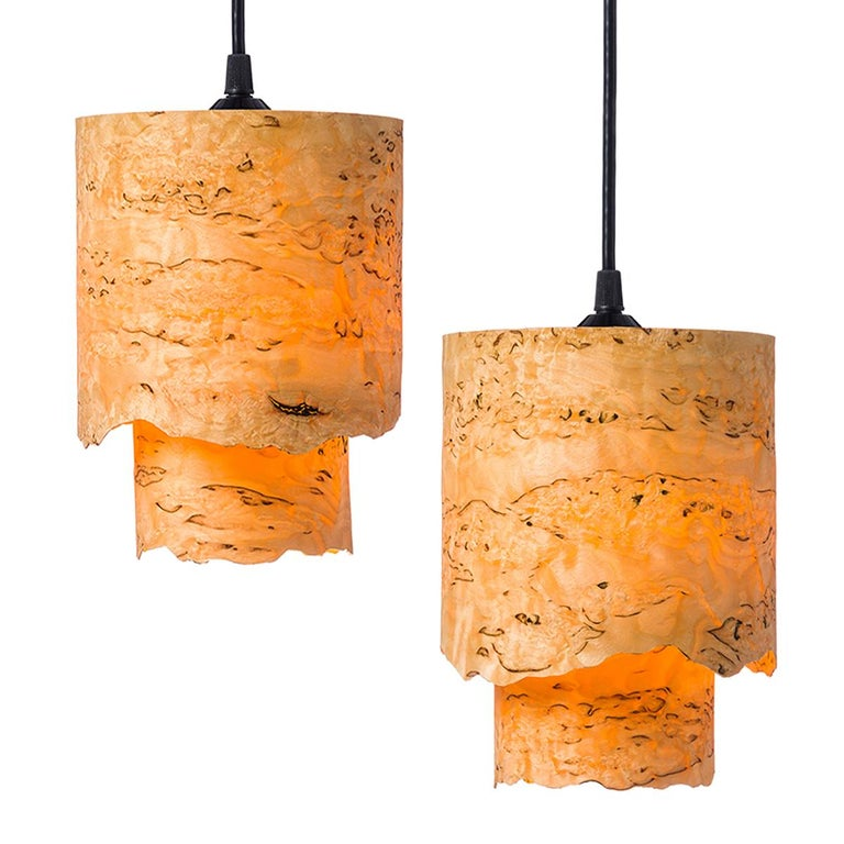 Cylindrical mini pendant in Karelian burl wood with live edge veneer, CIRCA gives a warm light. This Mid-Century Modern lighting is a designer style going well with furniture like bars, alcoves, side tables, book cases, cabinets and chests. There