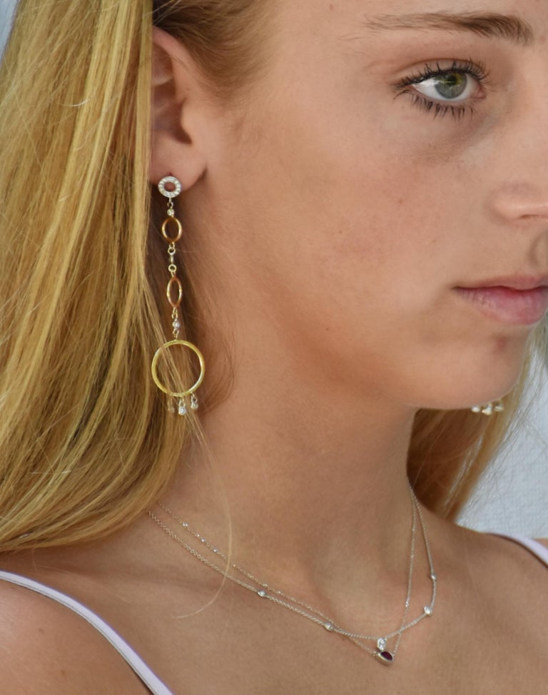 Fourteen karat white gold alternating with yellow gold circle earrings Earrings 3