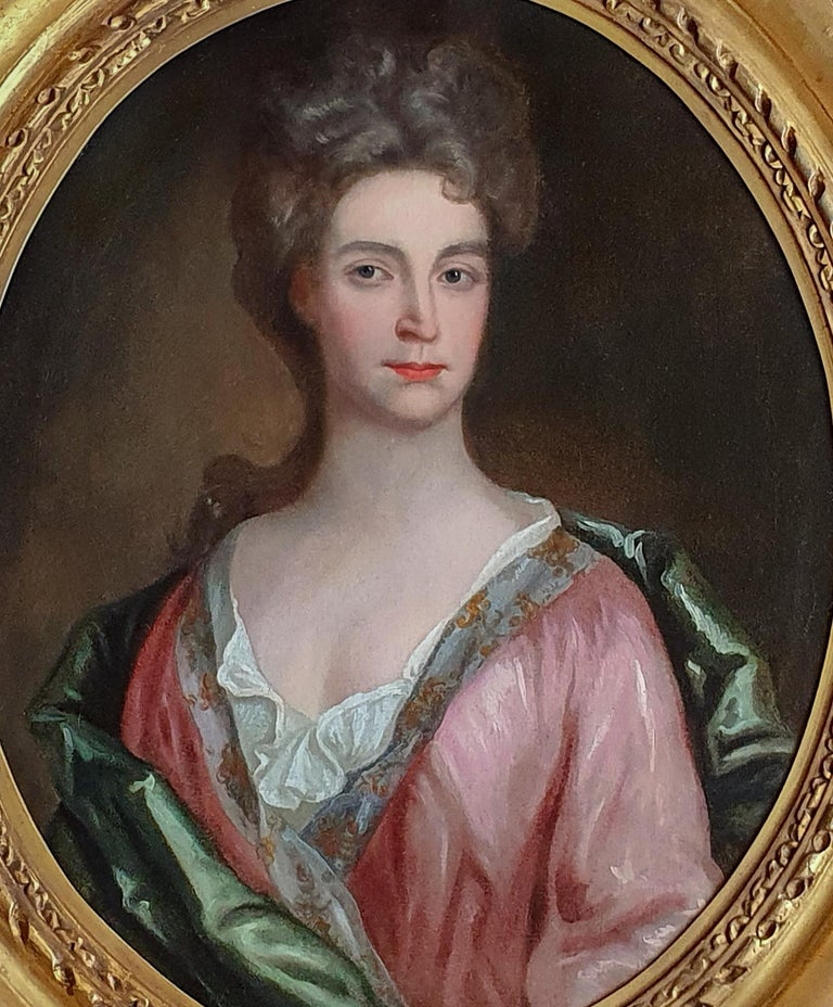 This elegant portrait is a type favoured by Godfrey Kneller's refined court-style depiction of aristocratic women.  The sitter is unencumbered by high fashion or a background of stately topography. The emphasis is instead placed directly on feminine