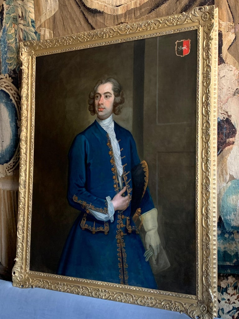 18th Century English Portrait of John Neale of Allesley Park in a Blue Coat - Beige Interior Painting by (Circle of) William Hogarth