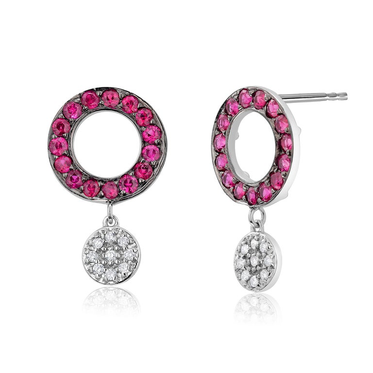 Fourteen karats white gold diamond and Blackened ruby circle cluster earrings  Two round-shaped diamond drops weighing 0.20 carats Round pave rubies circles, blackened, weighing 1.30 carats  Ruby hue tone color is rose red  New Earrings Handmade in