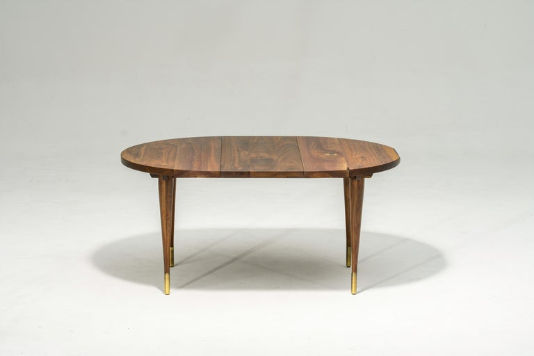 American Circle Walnut Expanding Dining Table w/ Brass Capped Legs
