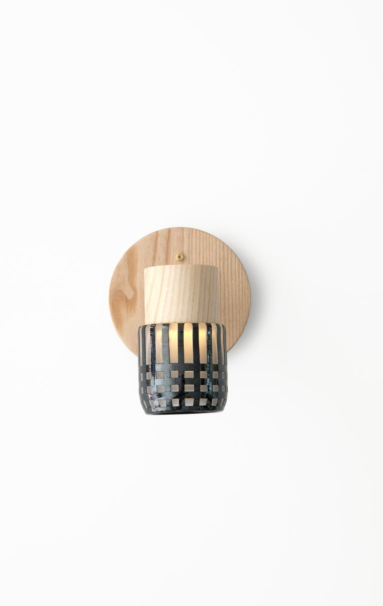 This handmade sconce pairs a minimal solid wood canopy with a hand blown glass diffuser. Efficient LED lighting components are neatly hidden in each canopy allowing the glass diffuser to illuminate without a visible bulb. 