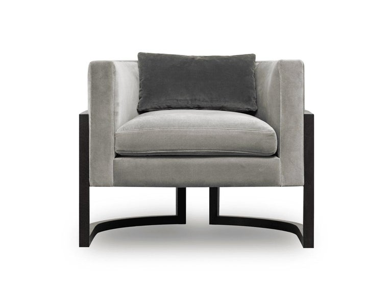 Contemporary lounge chair. The seat is upholstered in 100% cotton velvet and the back in woven cane. The darkened wood structure provides strength and lightness to the piece. Materials: Upholstered in cream or grey 100% velvet, black oakwood