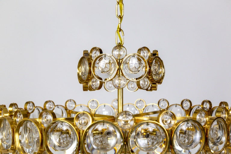20th Century Circular Gilt Brass and Optical Lens Crystal Multi Tier Chandelier by Palwa