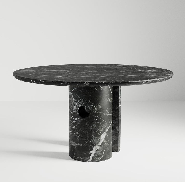 """Meta — which means """"half"""" in Italian — is a table that fuses Primitive and modern design using simple Euclidean geometry.   The top has a soft, rounded-edge profile that rests on two semi-circular columns made from a single block of stone. The"""