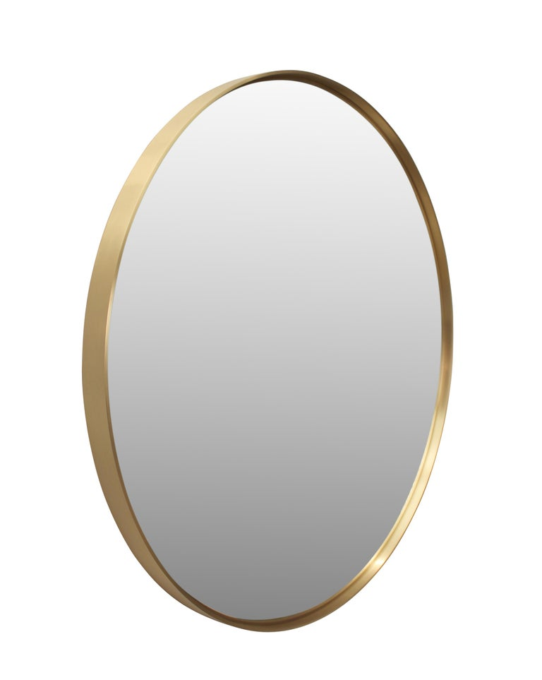 Customizable round mirror in satin brass or copper, can be ordered in custom sizes and any metal finish.