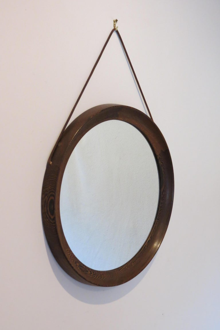 Swedish circular wall hanging mirror by Uno and Osten Kristiansson and manufactured by Luxus, Sweden.