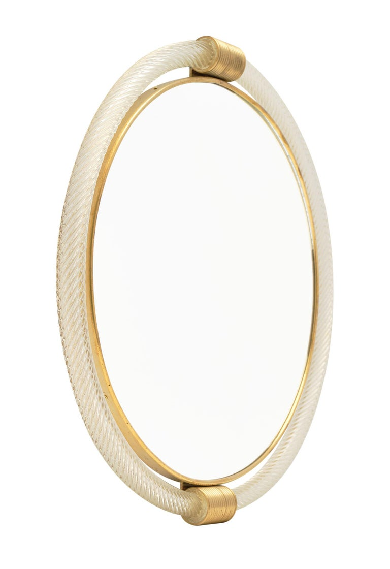 """Circular Murano glass """"torsado"""" mirror by Giuliano Fuga. We love the brass framed circular glass mirror surrounded by hand blown """"torsado"""" glass with 23-carat gold fused within. A striking mirror!"""